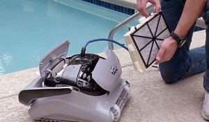 Cleaning the filters on your Dolphin robotic pool cleaner is meant to be easy! (Pictured: Rinse with water after each use.)