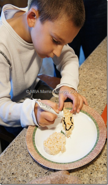 Boy Decorating Rice Krispies treats