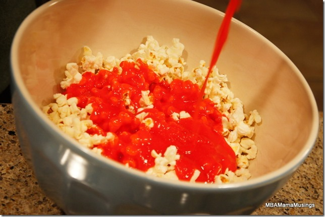 Pouring Jell-o Mixture on Popcorn