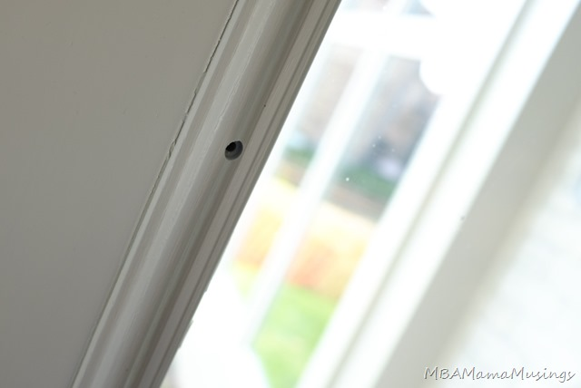 Screw Covers Removed from Glass Door Window Insert