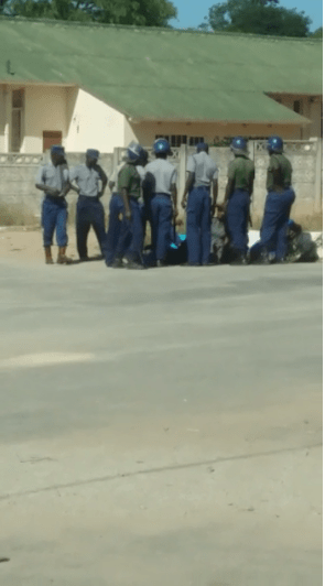 Police beating people