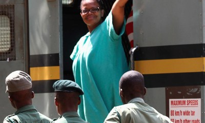 Zimbabwe's Lawyers For Human Rights Board Member Mtetwa waves as she arrives at Harare Magistrates Court
