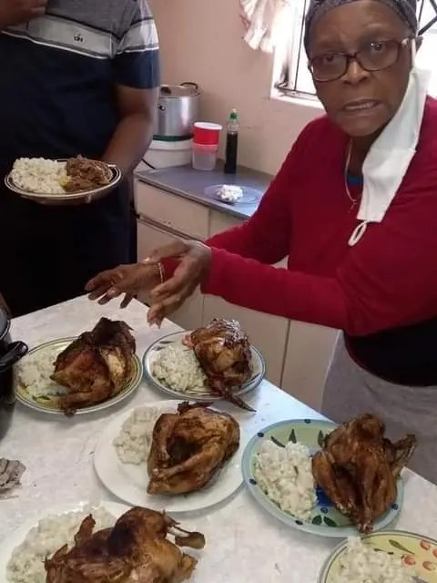 Family feeding on whole Chicken