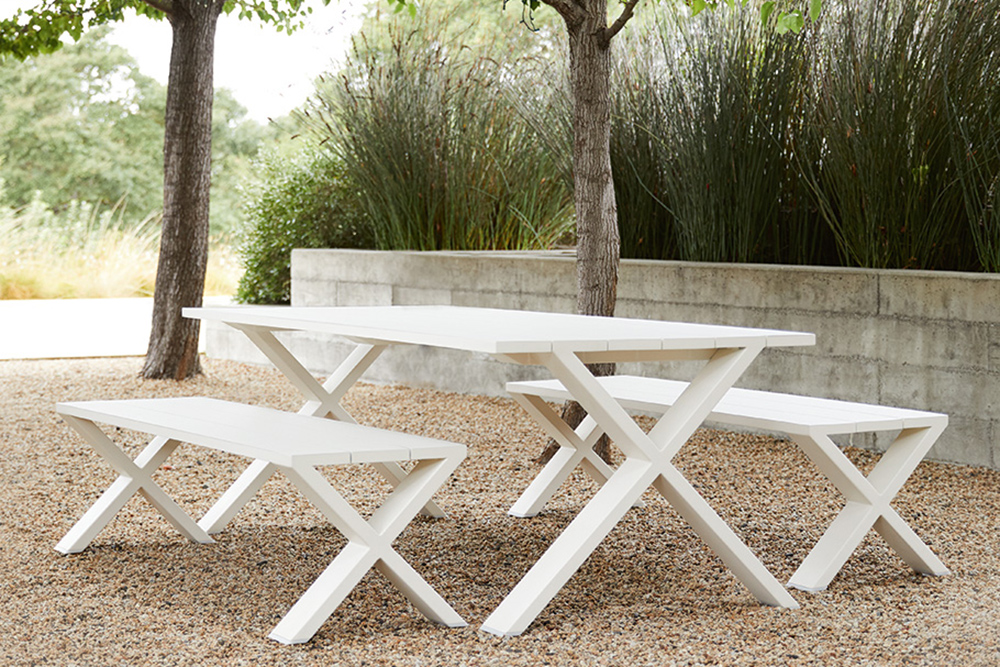 White outdoor table and bench