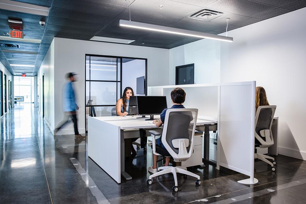 Space divider between two desks