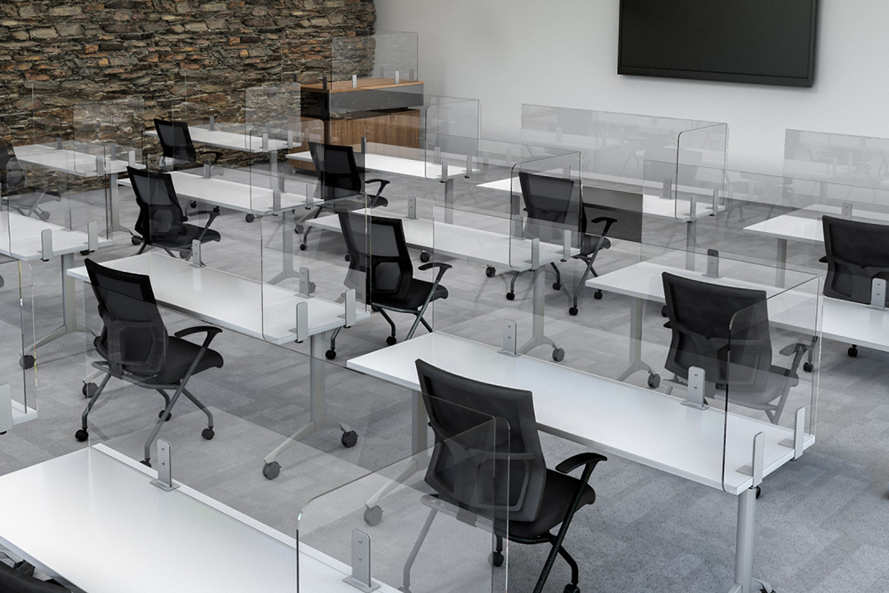 Training room with clear dividers and black chairs