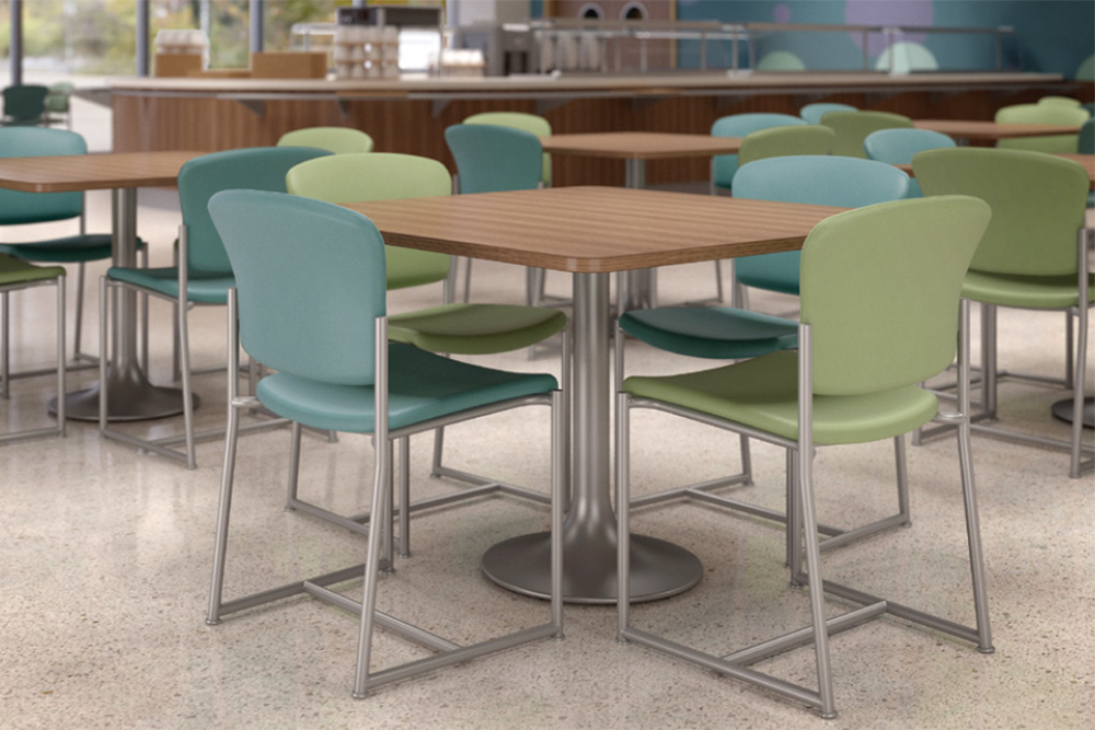Square tables with silver base in cafe
