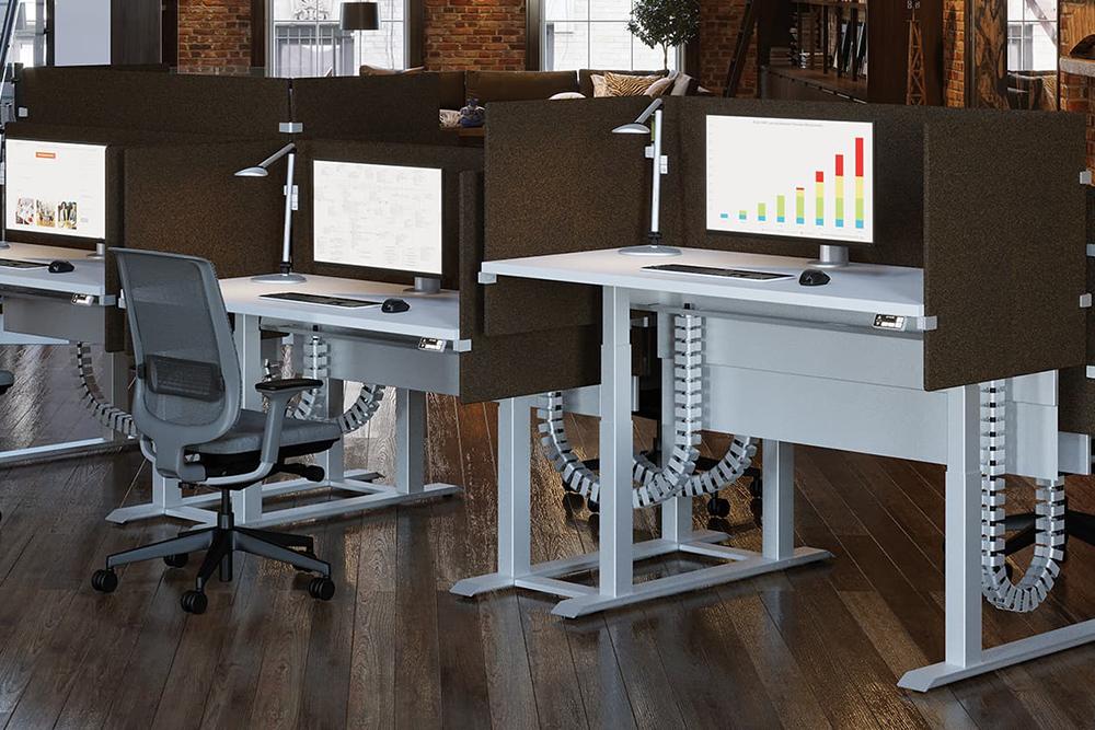 Height adjustable desks in office