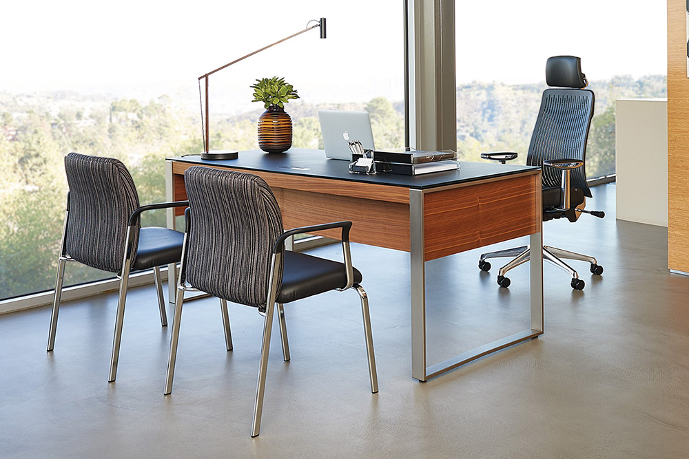 Office desk with task chair and two guest chairs