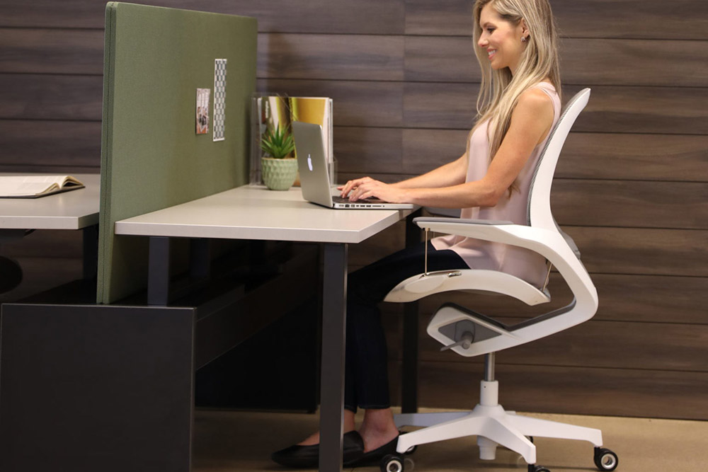 Woman sitting in a suspended responsive task chair