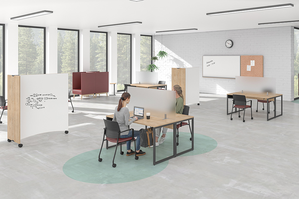 Open space floor plan with protective screens, tables, chairs, and white boards