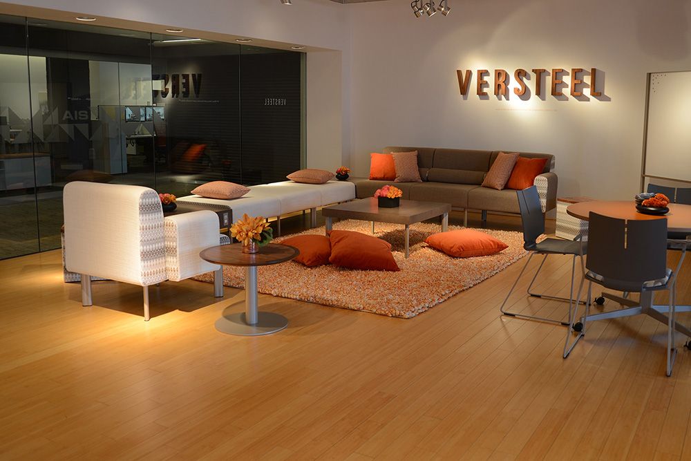office lounge with sofas, chairs, and tables