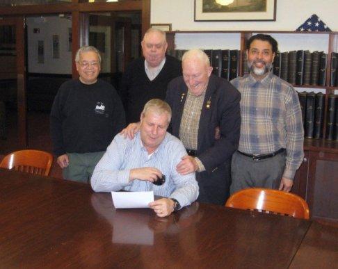 (L to R) MBDO Director Brotonel, Director Huntington, VP Walker, Secretary Galarza welcome Jim Opolony as a Director (seated).