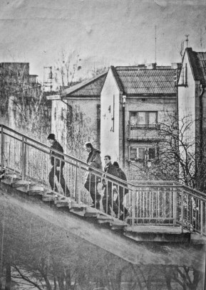 Black and white photograph of four youths climbing stairs in post-Soviet Lutsk, Ukraine in 1997.