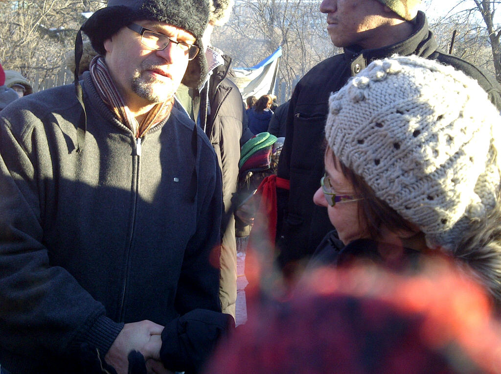Rick Cober Bauman, MCC Ontario executive director, greets Attawapiskat Chief Theresa Spence on the 24th day of her hunger strike.