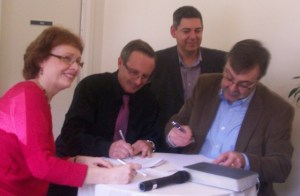 ETEM-IBVIE president Kristen Corrigan, ETEM-IBVIE dean Jean Martin, IBQ dean Jonathan Bersot, IBQ president Gary Connors sign partnership agreement.