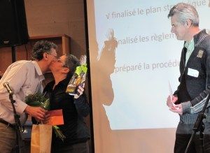 AEFMQ executive secretary Gilles Dextraze embraces Ginette Bastien. The gathering gave a standing ovation as AEFMQ board secretary Robert Dagenais thanked Bastien for her three years as board president.