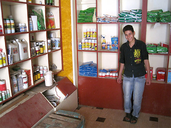 Bola Melad Ragheb, who limps because of polio, stands in the shop where he works after school, earning enough money to pay for his sister's school costs. He credits an MCC Global Family education program with giving him the confidence to apply. MCC Photo: Isaac Friesen