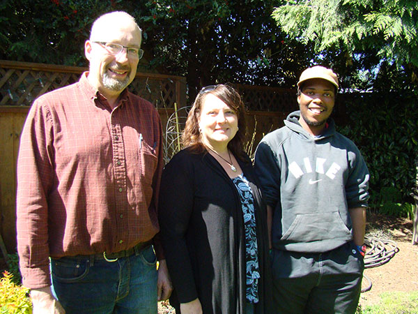Murray and Cheryl Siemens say that their lives have been enriched by IVEPer Rorisang Moliko who comes from Lesotho and is spending this year learning new farming techniques at Siemens' Willow View Farms.  MCC Photo: Angelika Dawson