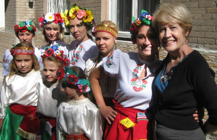Evelyn Wiens with the Ukrainian dance group from the orphanage on the first day of school. Photo: John Wiens