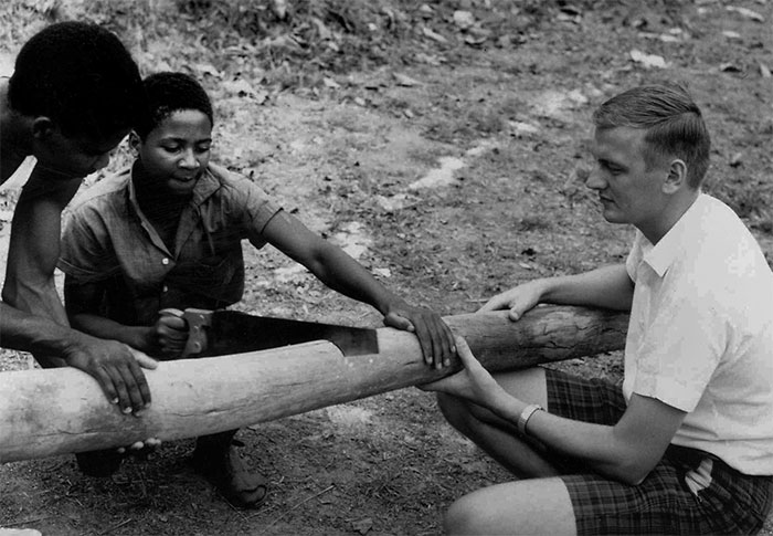 Tap memory bank 1: In 1965, Ron Mathies works with students to ready a pole and a hoop for a basketball court at Blantyre Secondary School, Malawi. Mathies went on to become MCC executive director from 1996–2005. PHOTO courtesy: Ron Mathies