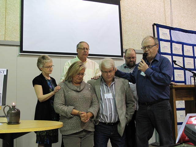 Hope Fellowship Church, Saskatoon, moderator prays for SKMB new director of ministry Terrance Froese and his wife Wanda.