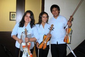 Members of the Recycled Orchestra play instruments constructed from garbage found in Paraguay's Cateura landfill. PHOTO: Rachel Dyck