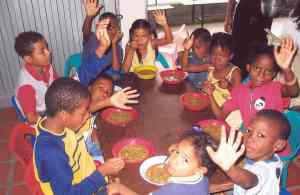 Children in Paraguay eat a meal from the Gleaners.