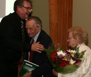 Stillwood director Harry Edwards honours board member and champion John Redekop. PHOTO: Craig Carmichael