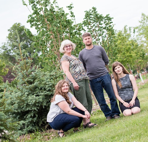 Eric Schmidt's family (from left) daughter Amanda, wife Anne, son Alex, and daughter Jessica, (missing: Matthew) with memorial tree.