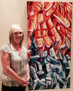 "Winnipeg artist Faye Hall with her Human Rights Showcase painting ""Fire & Ice"" inspired by Dirk Willems."