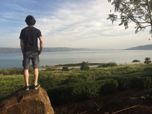An MBCI student surveys the Sea of Galilee.