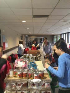 Northview volunteers fill Starfish backpacks with weekend food staples for hungry families.