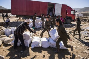 Democratic Peoples Republic of Korea (DPRK) is an MCC country of sensitivity. Please follow MCC Communications content vetting guidelines (below) before using these photos. Media caption: MCC partner First Steps delivered food assistance to Yonsa County, Democratic People's Republic of Korea, after flooding caused by Typhoon Lionrock. (MCC Photo/John Lehmann)   Other information: Community members in Musan county, Democratic People's Republic of Korea (DPRK), also known as North Korea help distribute relief supplies brought in by MCC partner First Steps. From August 28 to September 2, heavy rains caused by Typhoon Lionrock pounded northeast part of DPRK, causing flooding and landslides in six counties of Hamgyong province. According to the UN, 138 people were killed, more than 69,000 are still displaced and 600,000 people are in need of assistance. DPRK is a chronically food-insecure country which is prone to disasters, particularly flooding. MCC's partnerships in the country meant hundreds of people received relief kits and food shortly after the flooding took place. In September, MCC's partner, Christian Friends of Korea (CFK), distributed 500 MCC relief kits and 110 school kits to respond to the flooding in Musan and Yonsa counties. In addition, MCC, through First Steps, will purchase 6,060 square meters of corrugated steel roofing for rebuilding damaged daycares, kindergartens, and clinics in Yonsa. Approximately 4,200 children will benefit from this project.