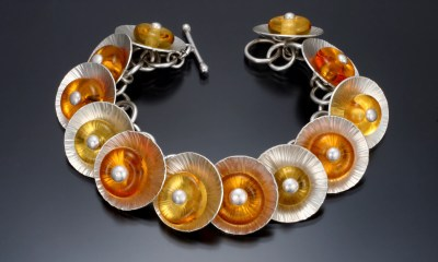 Yellow and orange glass centers on a Sunflower Bracelet  Carol Holaday