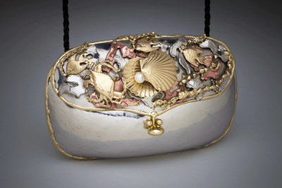 Hung object is a metal art purse  Mundy with metal shells and kelp