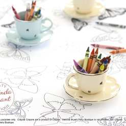 closeup of cute tea cups filled with crayons