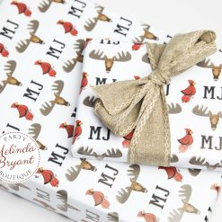 monogrammed wrapping paper with moose and cardinal