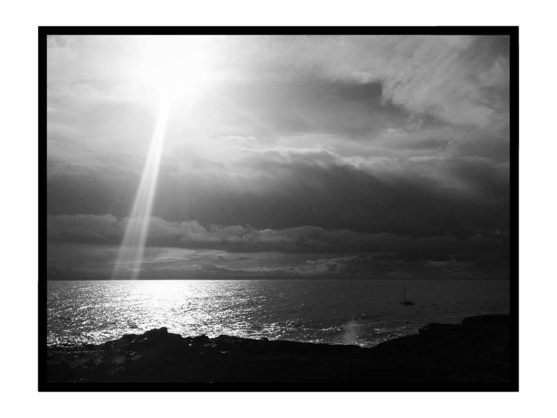 black and white scottish sea with sun