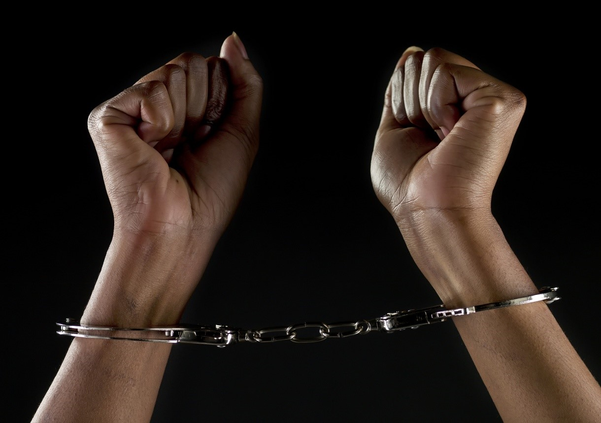 Black woman in handcuffs