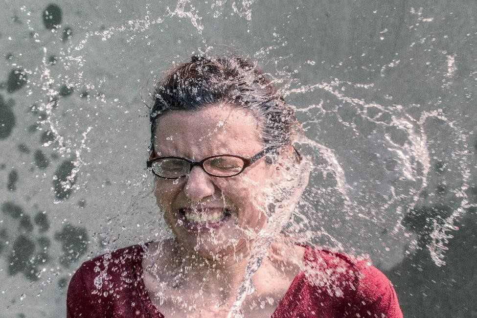 woman with water splash in her face