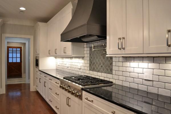 farmhouse kitchen with metal range hood