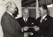 "From the front page, Sheffield Star, May 9, 1963. RAILWAY guard, Mr. Stanley Mercer (right), who fought a fire in the brake van of a Sheffield to York train, today received a thank you cheque from Mr. S.C. Webb, traffic manager. Looking on is Mr. P. Williamson, Sheffield Victoria Station Master. See ""Blaze train guard"" - Page 5."
