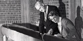 Thomas M.N. Lewis and Madeline D. Kneberg with the McClung Museum's dugout canoe, c. 1950s