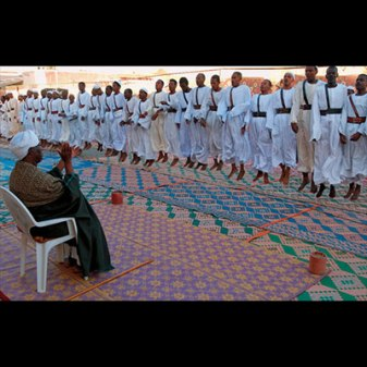 Friday Dhikr of the Sammaniyya Sufi Sect. During a Dhikr, followers engage in rigorous exercise while chanting the names of God or Qu'ranic phrases. (Omdurman, 2003)