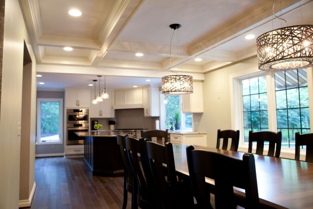Wood table with white coffered ceilings above