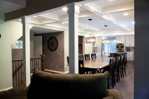 Looking into the dining room through white trimmed columns