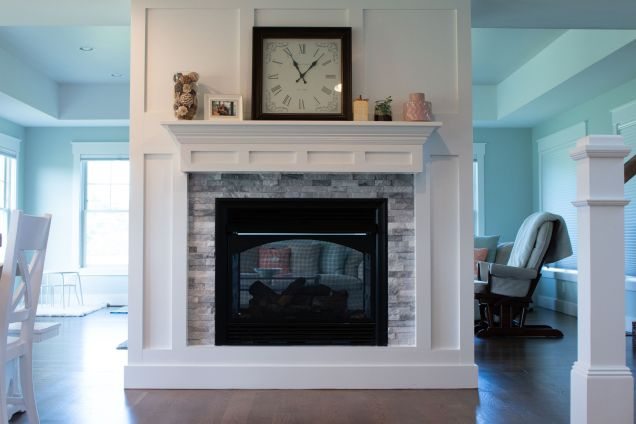 See thru fireplace with wood trim surround
