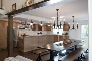 Rustic eating area with kitchen beyond