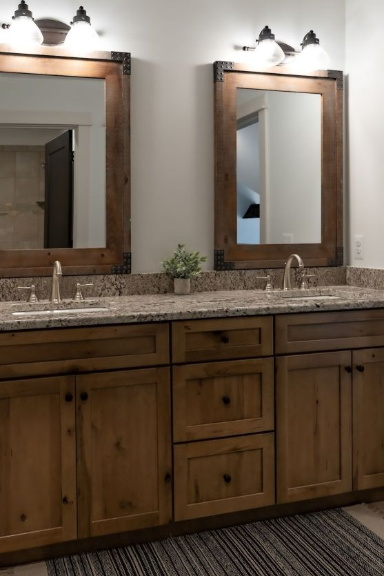 knotty pine cabinets with wood trimmed mirrors